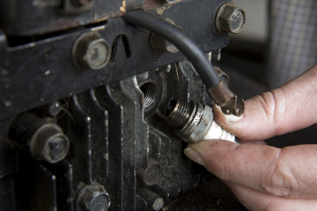 Changing a spark plug in a small gas engine