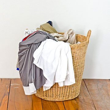 laundry hamper filled with dirty clothes